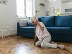 Senior Woman Suffering From Faint Lying on Floor After Falling Down at Home. Elderly Woman Fell on the Floor